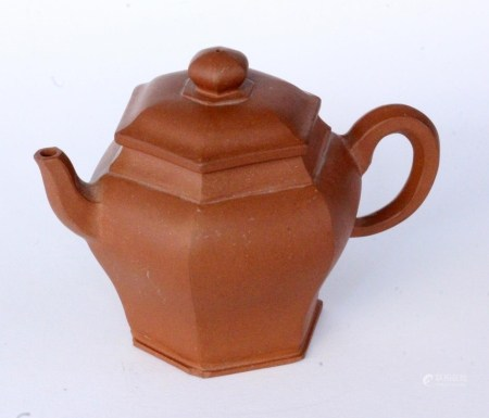 A TEA POT China, probably Qing Small Yxing pot made of reddish stoneware. Four character