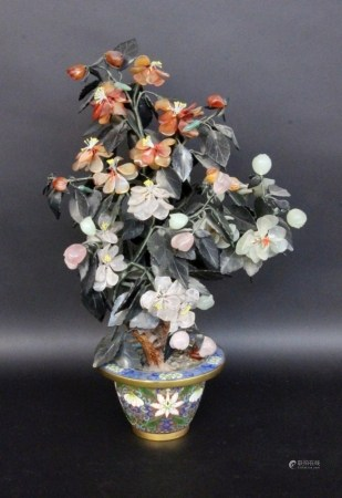 A JEWELLERY TREE China Small tree with leaves and flowers cut from gemstones in a brass