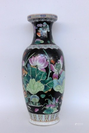 A BALUSTER FLOOR VASE China Porcelain with black ground and colourfully painted flowers.