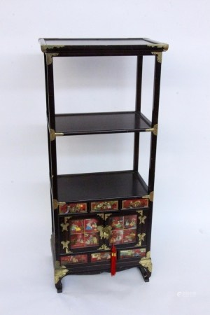 A CHINESE SHELF UNIT Mahogany, stained. In the lower part, drawers and 2 doors.
