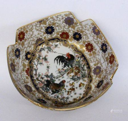 AN ASIAN STYLE PORCELAIN BOWL Painted with chicken and stylized flowers. 11 cm high,