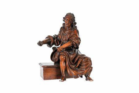 Statue de saint en bois sculpté