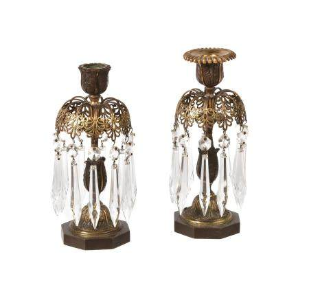 A pair of Regency parcel gilt and patinated bronze lustre candlesticks