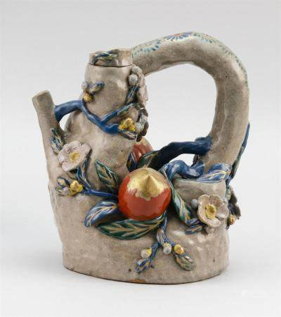 """JAPANESE AWADA KYOTO WARE WINE EWER In the form of a tree stump, decorated with relief peaches and flower blossoms. Height 8.5""""."""