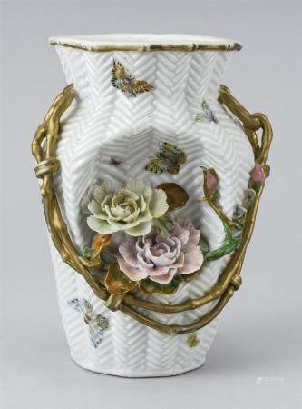 JAPANESE PORCELAIN WALL VASE In the form of a woven basket, with a relief bamboo handle, relief flowers and painted butterflies. Hei...