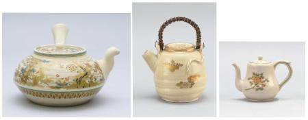 """THREE JAPANESE SATSUMA POTTERY TEAPOTS , 1) Circa 1860 squat ovoid teapot with side handle and Three Friends decoration on body of pine, prunus and bamboo. Length 6""""., 2) Circa 1900 ovoid teapot with paulownia and chr..."""
