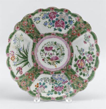 """CHINESE PORCELAIN FLORIFORM CHARGER With floral decoration. Six-character mark on base. Diameter 12.5""""."""