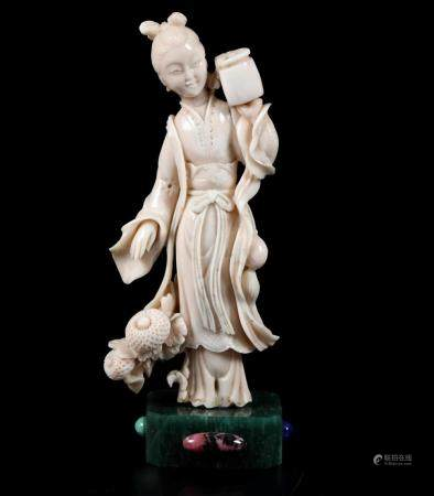 A carved coral figure, China, early 1900s