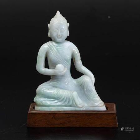 A jadeite Buddha figure, China, early 1900s