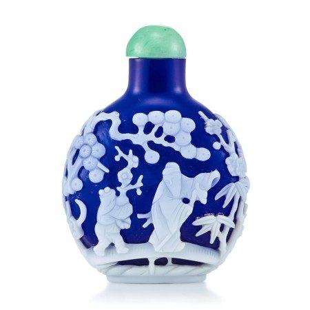 A White Overlay Cobalt-Blue Glass 'Scholar in a Pavilion' Snuff Bottle Qing Dynasty, 18th - 19th Century   清十八至十九世紀 藍地套白料高士圖鼻煙壺