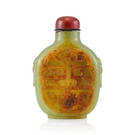 A Yellow and Russet Jade 'Dragons' Snuff Bottle Qing Dynasty, Qianlong Period   清乾隆 黃玉夔龍紋鋪獸首鼻煙壺