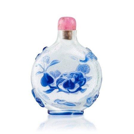A Blue-Overlay Glass 'Bats and Peach' Snuff Bottle Qing Dynasty, 18th Century   清十八世紀  雪霏地套藍料福壽鼻煙壺