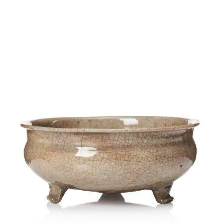 A pale celadon glazed tripod censer, Ming dynasty, 17th Century.