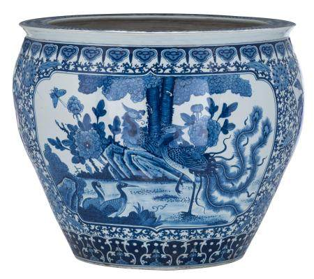 A Chinese blue and white cachepot, the panels decorated