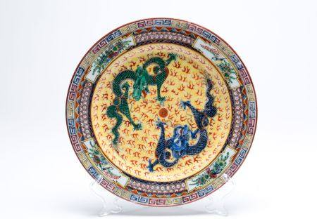 Porcelain chinese yellow plate. Early 20th c.