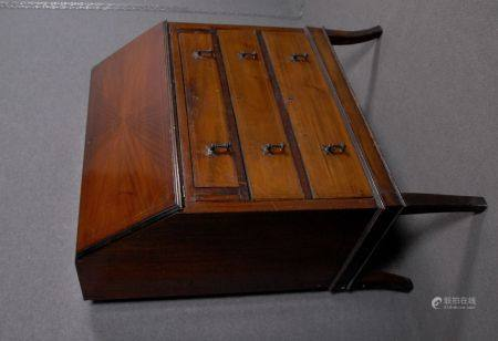 Small chest of drawers with saber feet. 19th c.
