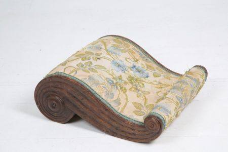 Padded wooden footrest. 19th century