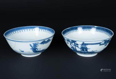 Chinese Art A pair of blu and white porcelain cups painted with landscape and bearing four character marks at the base. China, Qing dynasty, 18th century