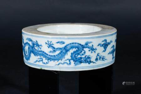 Chinese Art A porcelain blue and white inkwell element painted with dragons chasing the flaming pearl China, Qing dynasty, 19th century