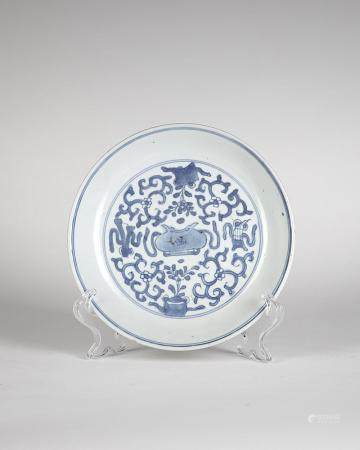 Chinese Art A blue and white porcelain dish painted with auspicious symbols and bearing a mark at the base China, Qing dynasty, 17th century