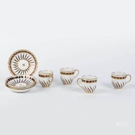 A SERIES OF FOUR LATE 18TH-CENTURY RIBBED CUPS AND SAUCERS. PARTLY GILT PORCELAIN ON A CREAM-COLOURE