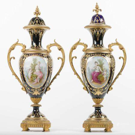 A PAIR OF EGG-SHAPED AND DOUBLE-HANDED SÈVRES VASES ON FOOT. PAINTED AT THE FRONT WITH A NYMPH AND