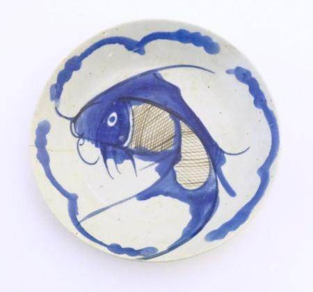 An Oriental blue and white plate with hand painted carp fish decoration. Character marks under. Appr