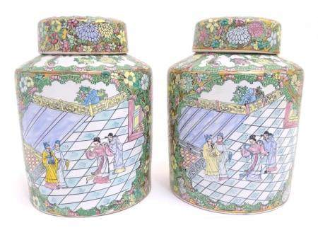 A pair of Chinese jars and covers profusely decorated with flowers and foliage, with two lobed centr