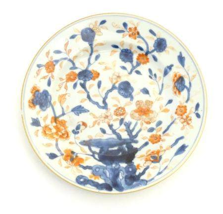 A Japanese plate in the Imari palette with hand painted decoration depicting blossoming flowers. App