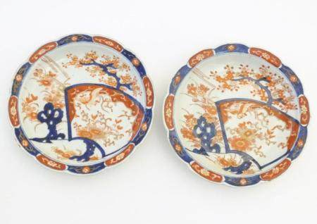 A pair of Japanese plates / dishes with lobed rims in the Imari palette with hand painted decoration