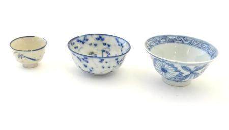 Three assorted Oriental blue and white wares to include saki cup, tea bowls etc. Character marks und