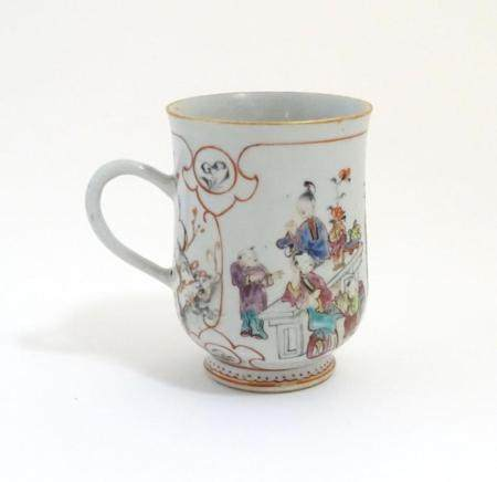 A Chinese export famille rose mug / tankard decorated with figures in a domestic interior scene, and