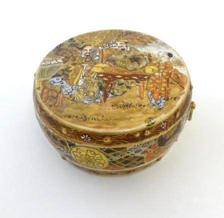 A Japanese Satsuma pot and cover. The cover decorated with a landscape scene with two scholar figure