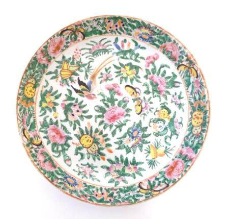 A Chinese Cantonese plate / dish decorated with birds, butterflies, flowers and foliage. Approx. 9 1