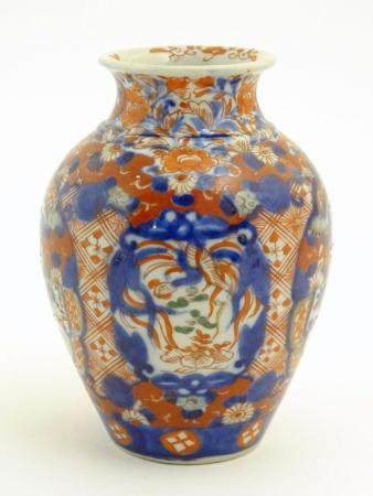A Japanese vase of baluster form decorated in the Imari palette with floral and foliate motifs. Appr