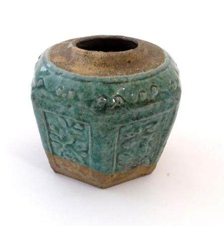 A Chinese hexagonal Shiwan ginger jar / vase with moulded floral and foliate detail with a blue / gr