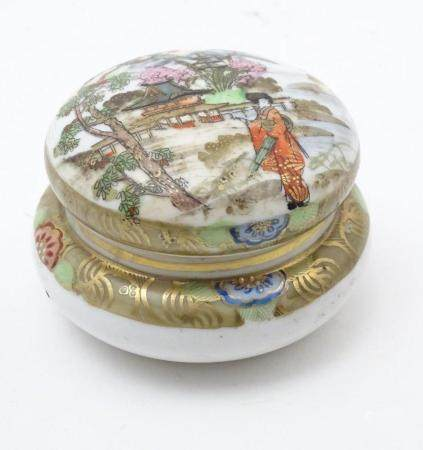 A Japanese Noritake circular pot and cover with hand painted decoration depicting a Geisha girl in a