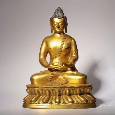 A GILT-BRONZE BUDDHA STATUE