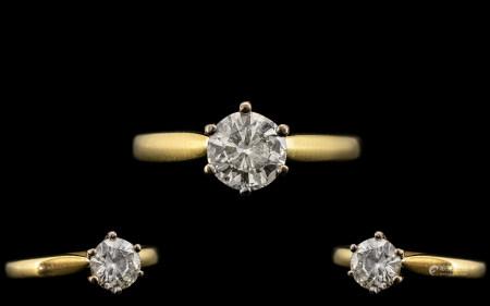 18ct Gold and Platinum Single Stone Diamond Ring. Full Hallmark for 750 - 18ct. The Round