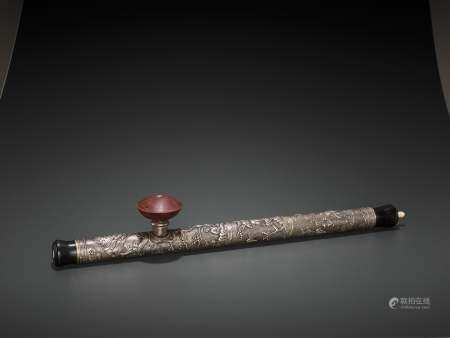 A HARDWOOD OPIUM PIPE WITH SILVER AND CERAMIC FITTINGS