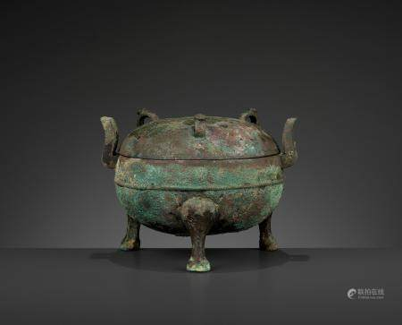 AN ARCHAIC TRIPOD VESSEL AND COVER, DING, EASTERN ZHOU