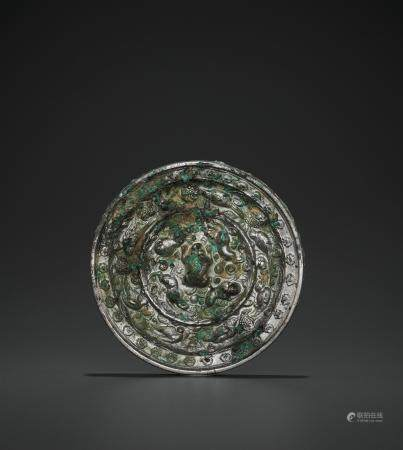 A SILVERED BRONZE 'LIONS AND GRAPEVINES' MIRROR, TANG