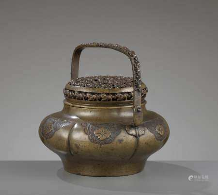 A 'HORSES' HANDWARMER WITH RETICULATED COVER, 17TH-18TH