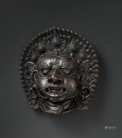 A MASSIVE BRONZE BHAIRAVA MASK, 18TH OR EARLIER