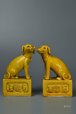 A pair of yellow glazed beasts
