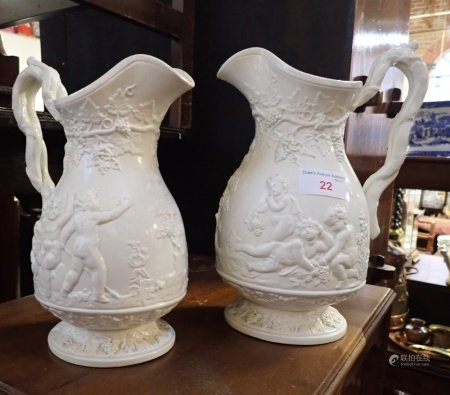 TWO MATCHING VICTORIAN RELIEF-MOULDED JUGS
