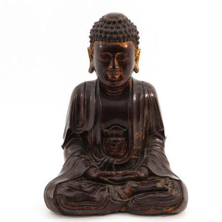 A Carved Wood Meditating Buddha