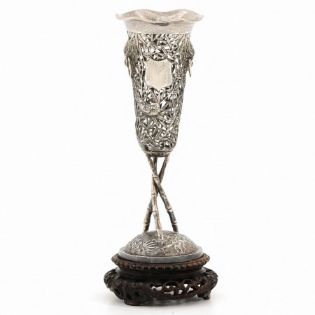 A Silver Vase on Wood Base