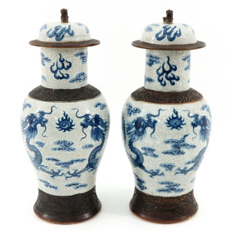 A Pair of Nanking Vases with Covers