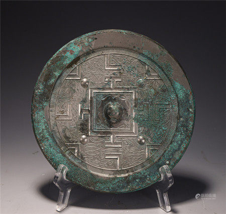 A CHINESE CARVED BRONZE MIRROR